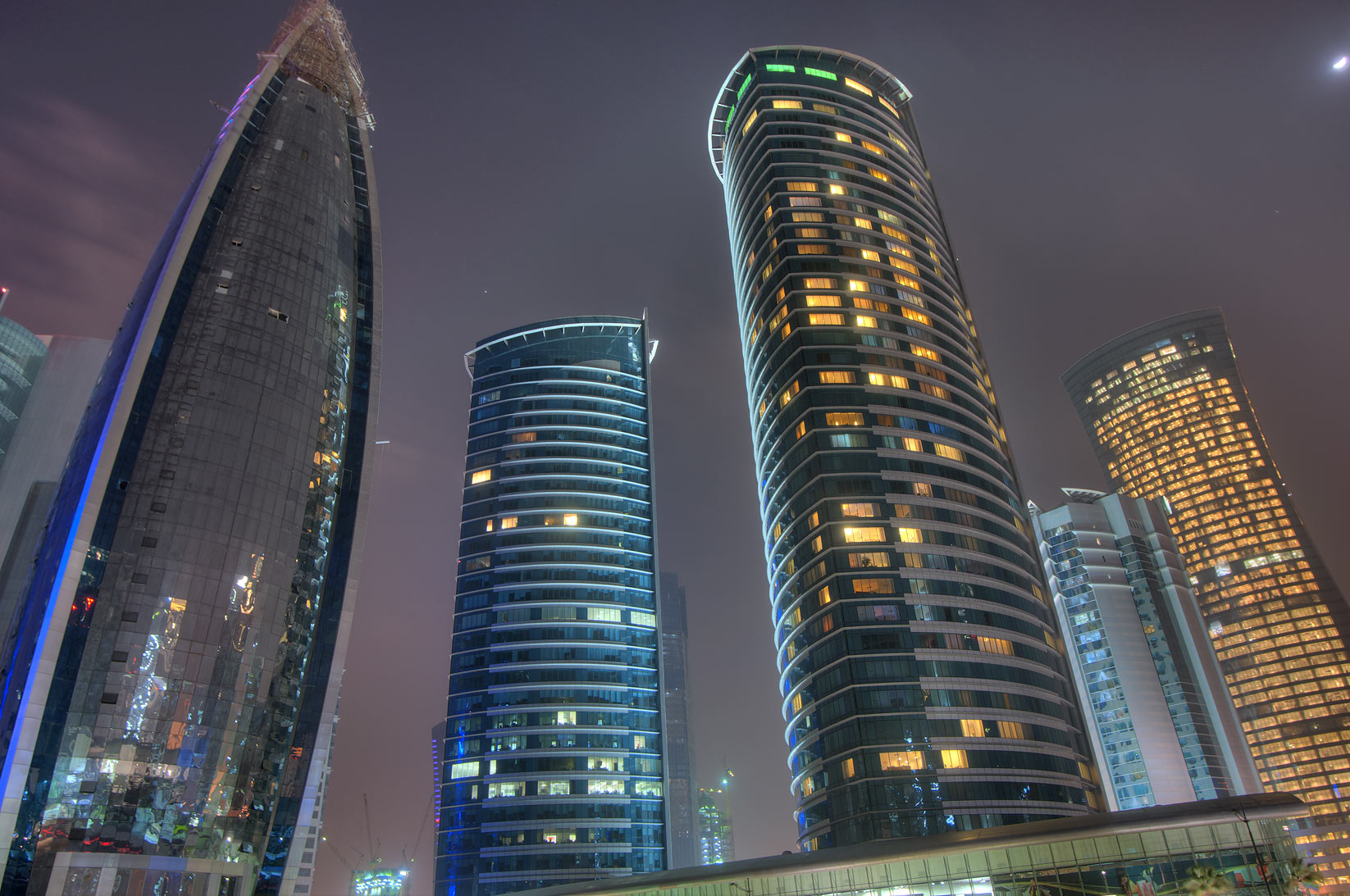 Woqod and twin Al Fardan towers in West Bay, view...behind City Center Mall. Doha, Qatar