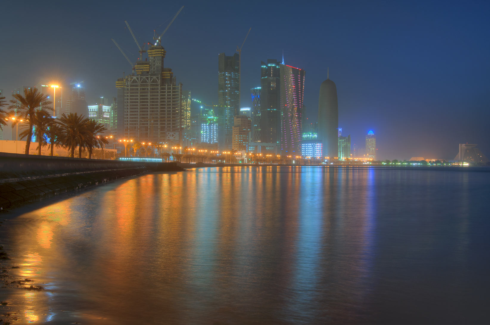 Corniche (seafront promenade) and West Bay at morning. Doha, Qatar