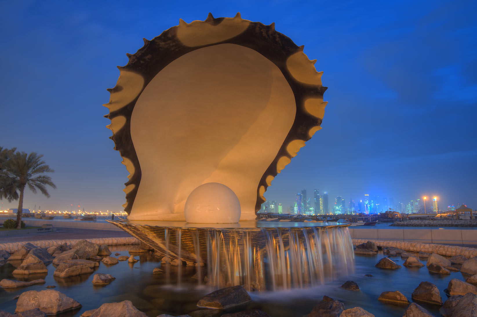 Oyster and Pearl Fountain on Corniche, with lights turned off. Doha, Qatar