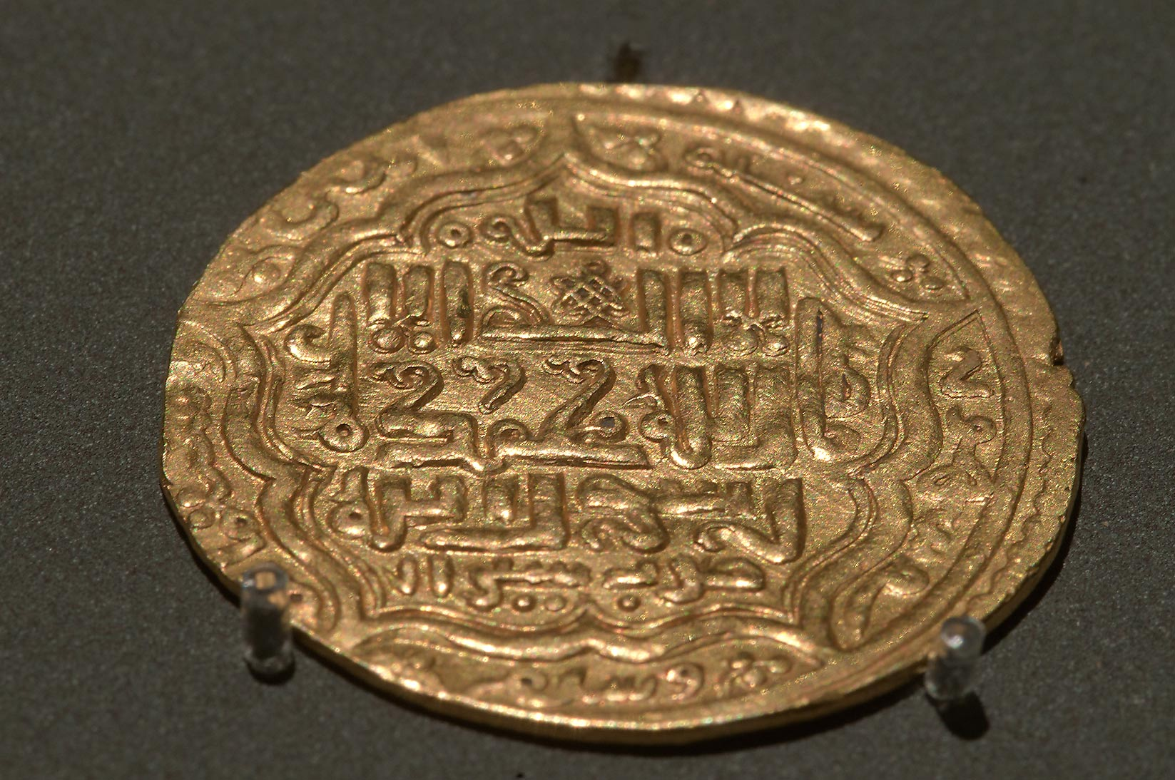 Iikhanid dinar (Iran, 1301-4) on display in Museum of Islamic Art. Doha, Qatar