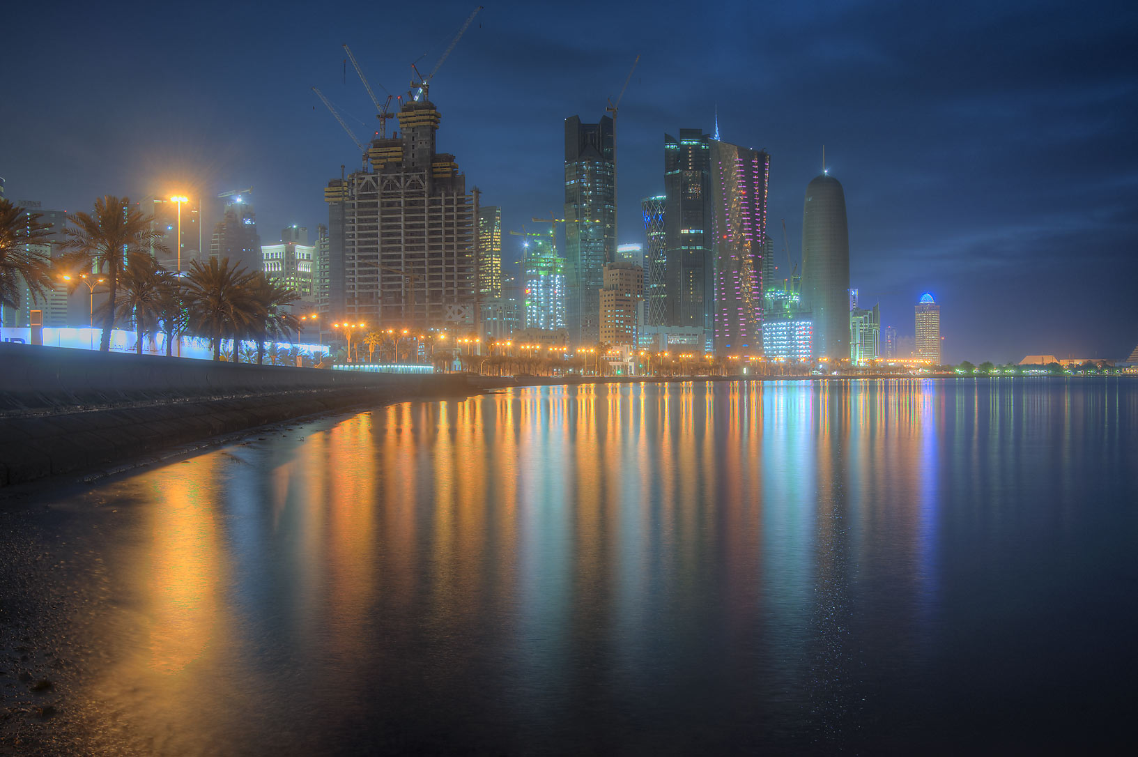 Reflections of West Bay lights from Corniche. Doha, Qatar
