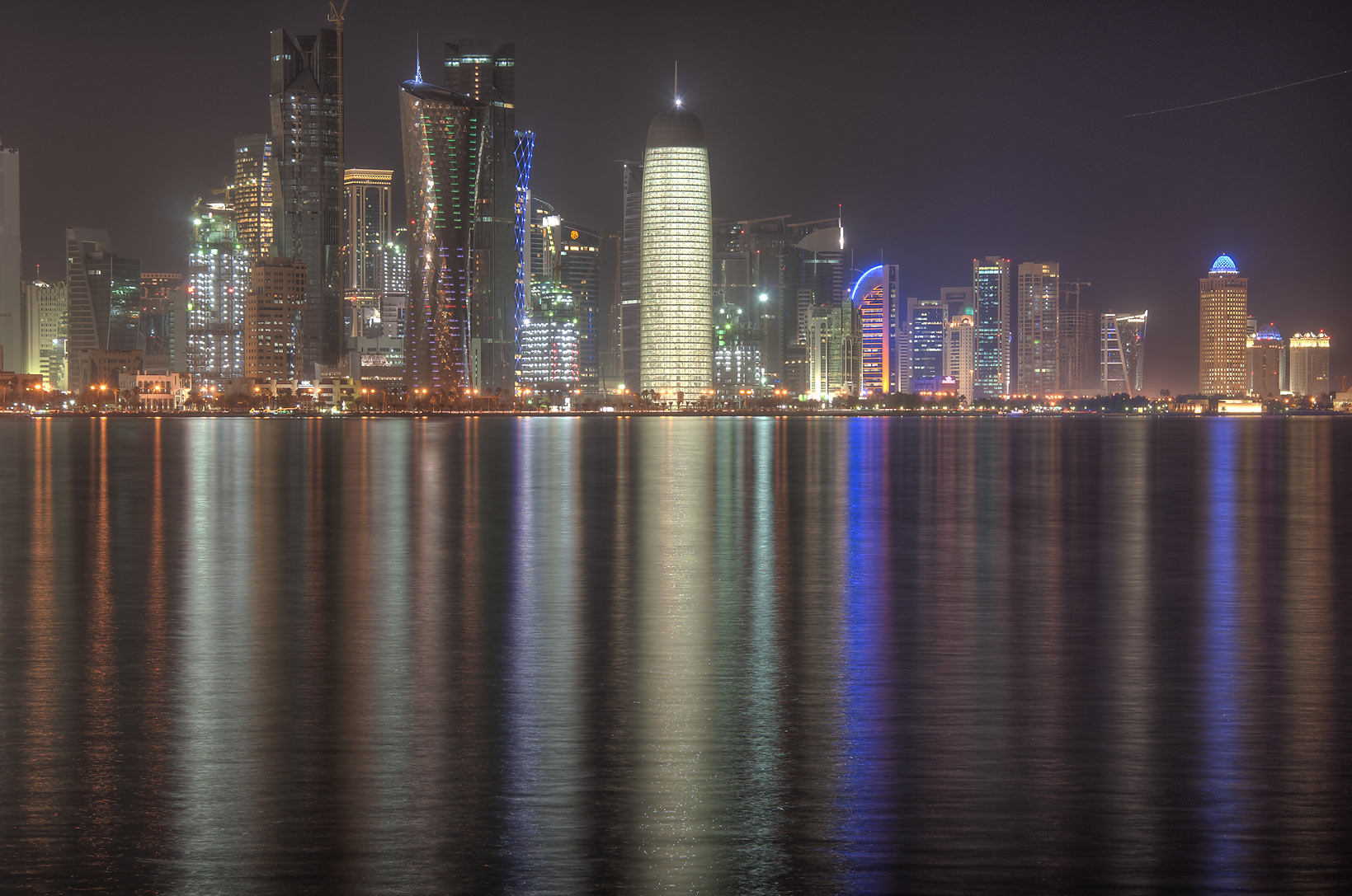 West Bay with illuminated Burj Qatar Tower (in...from Corniche at evening. Doha, Qatar