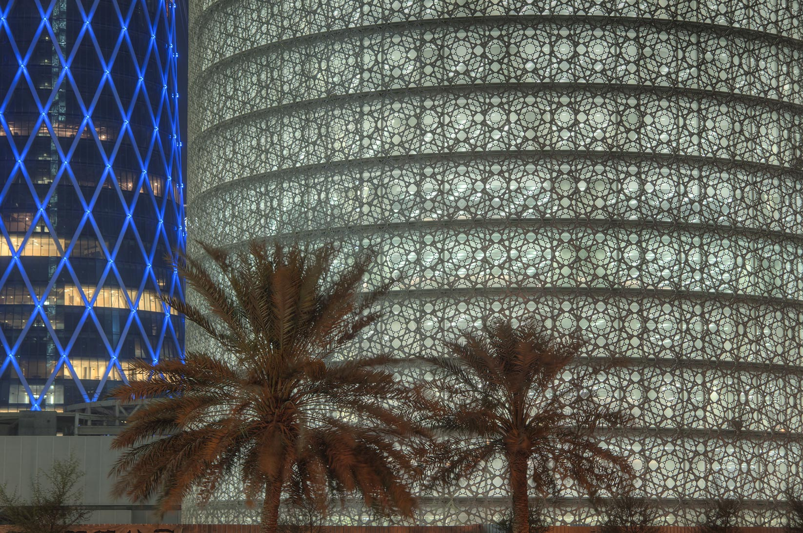 Burj Qatar Tower with lights turned on in West Bay from Corniche. Doha, Qatar