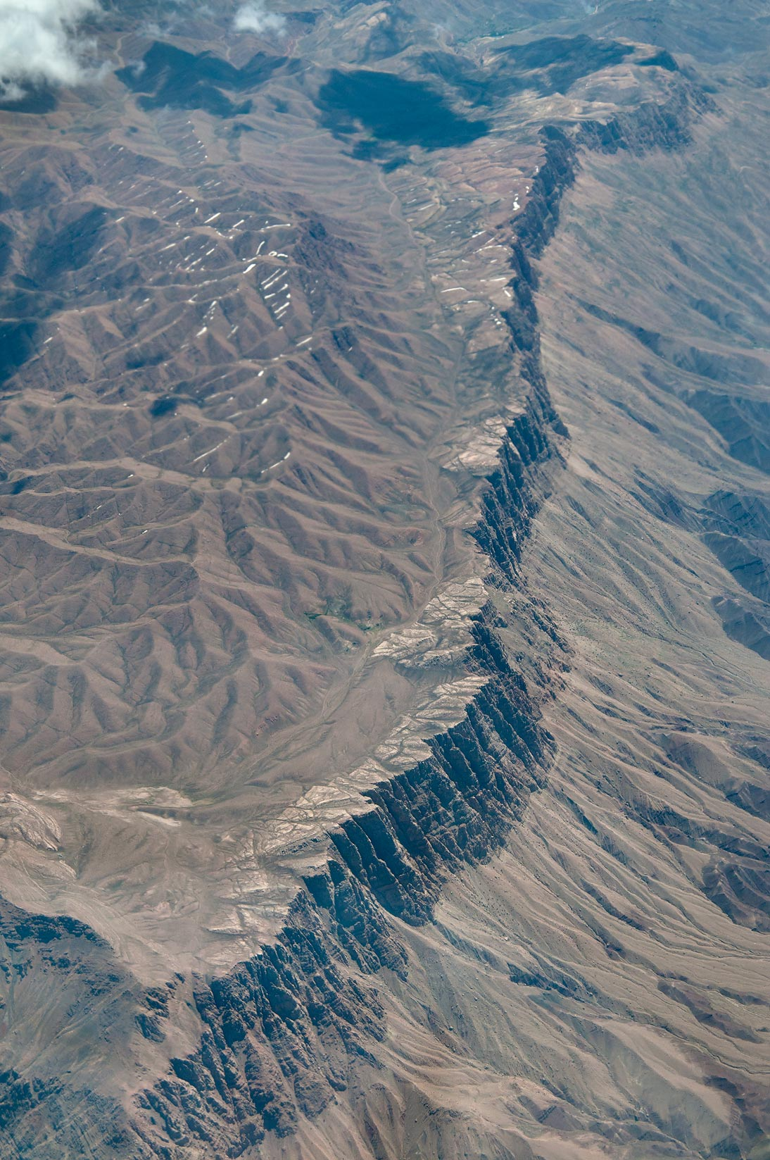 Mountain ridge in southern Iran, near Kerman...a plane from Dubai, UAE to Houston, TX