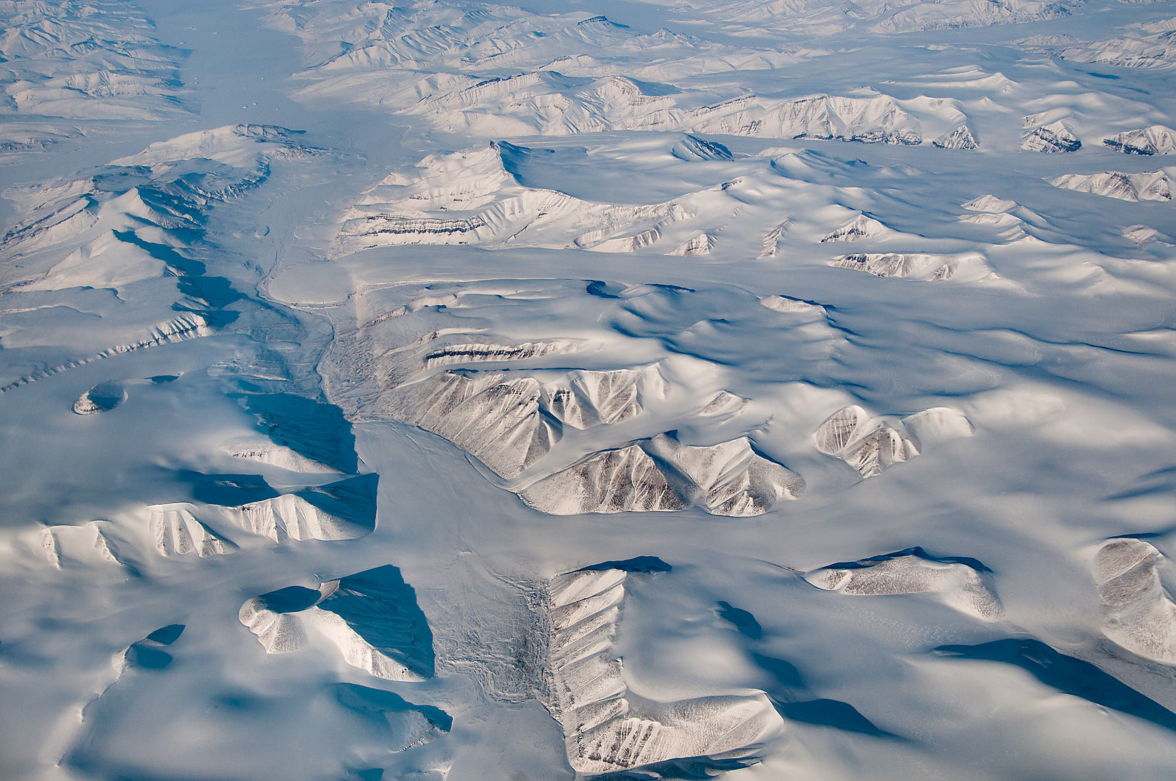 Glacier of Ellesmere Island, Canada. View from a...a plane from Dubai, UAE to Houston, TX