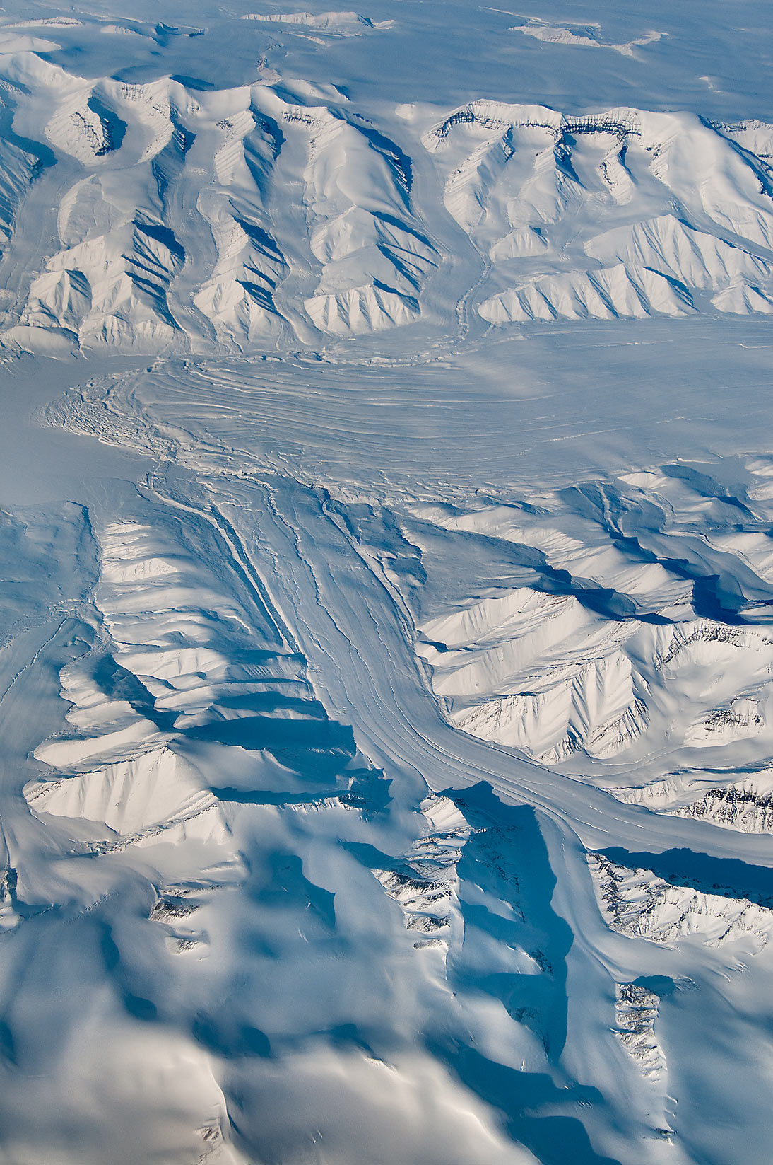 Glacier flowing in Arctic Cordillera mountain...a plane from Dubai, UAE to Houston, TX