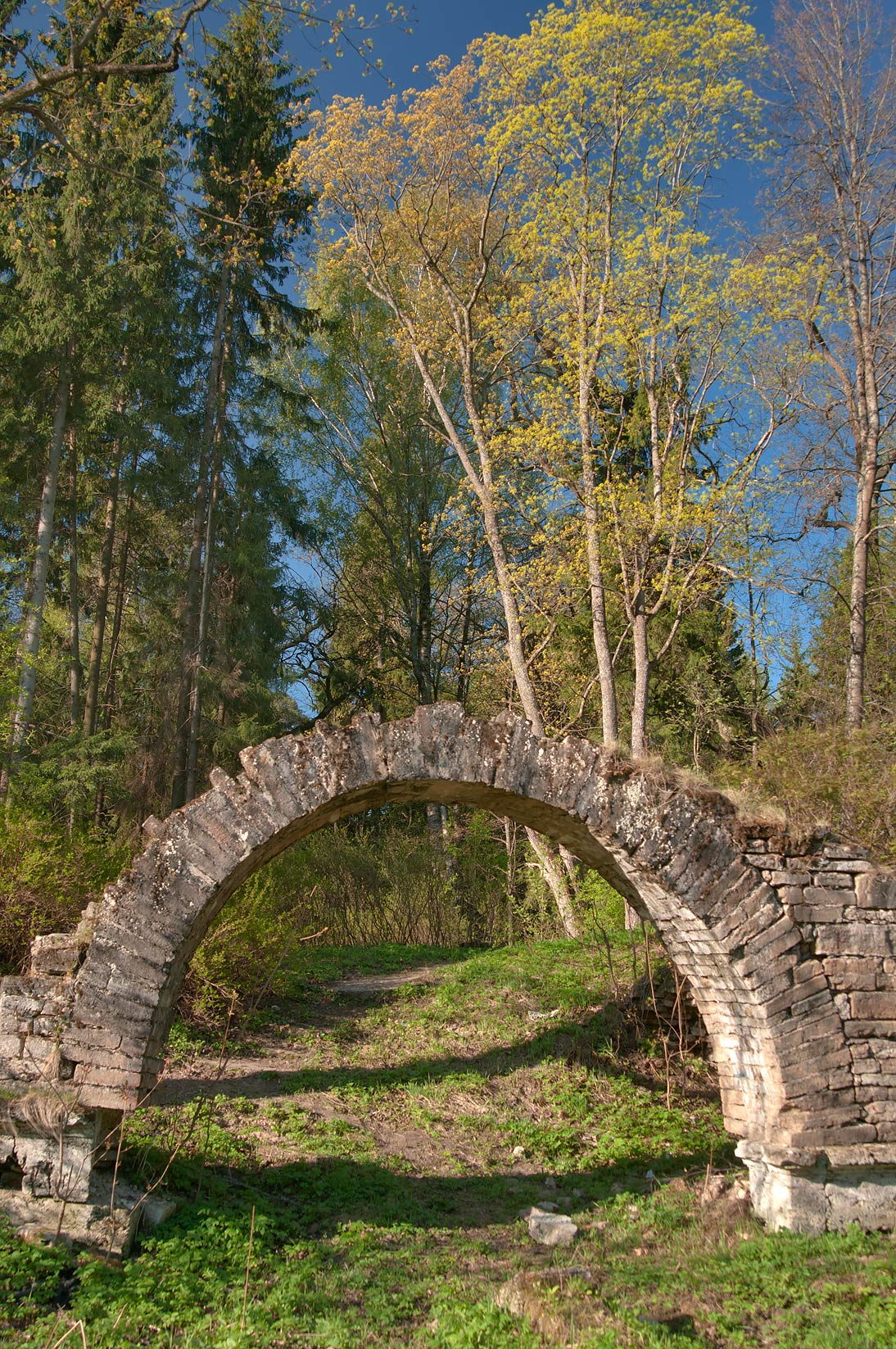 Stone arch of Ruins (1800-1803) near Slavyanka...Park, suburb of St.Petersburg. Russia