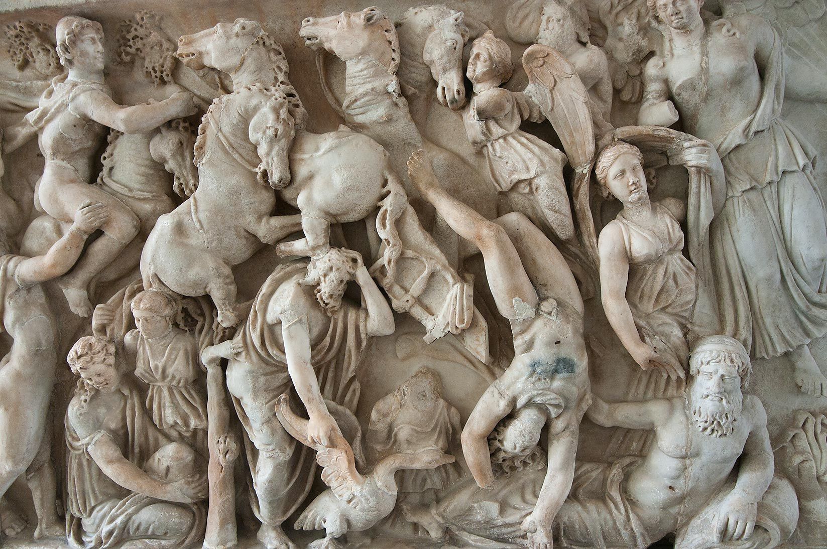 Marble relief on sarcophagus showing traffic jam...Museum. St.Petersburg, Russia