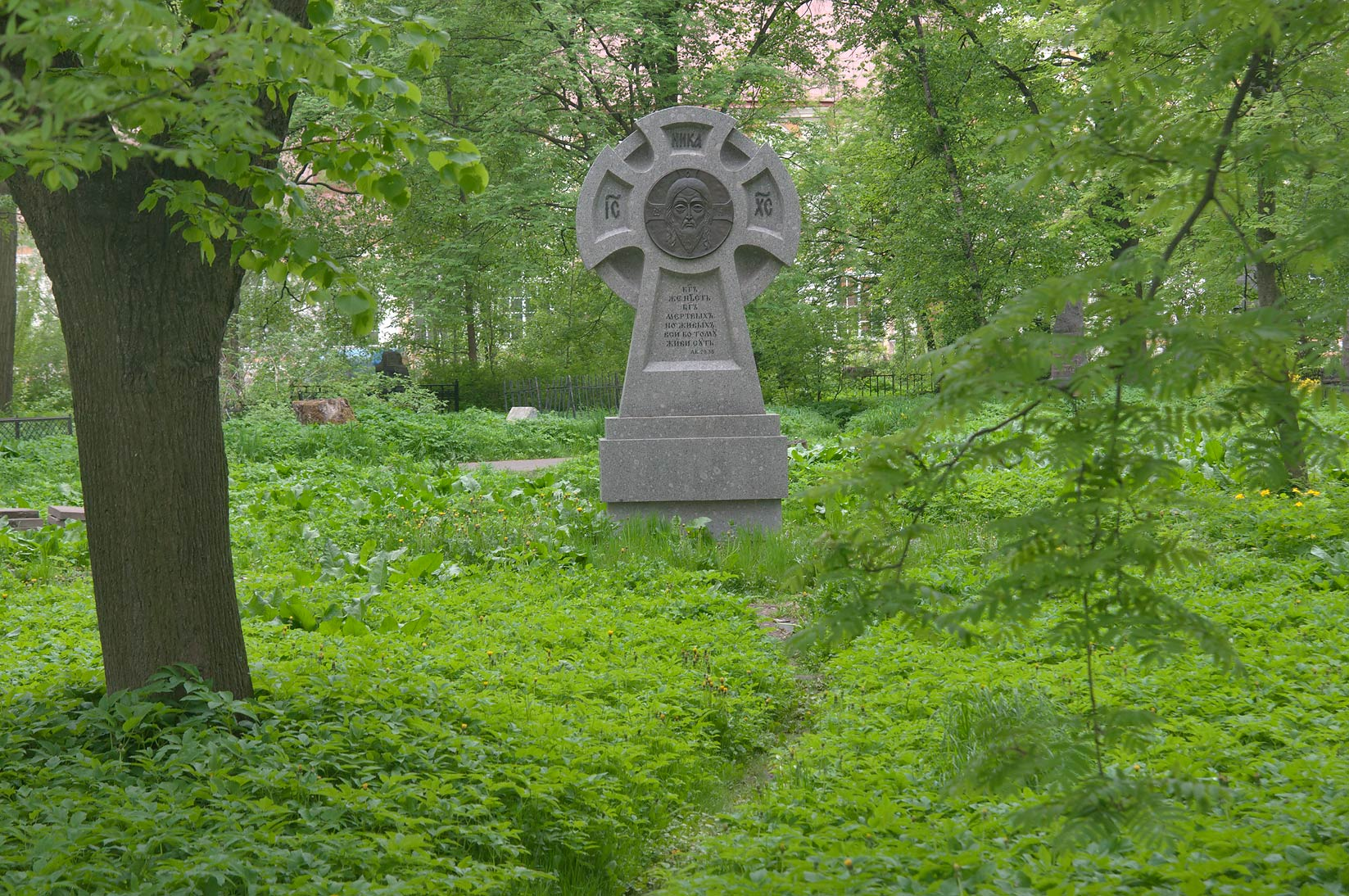Stone cross in a cemetery of Alexander Nevsky Lavra. St.Petersburg, Russia