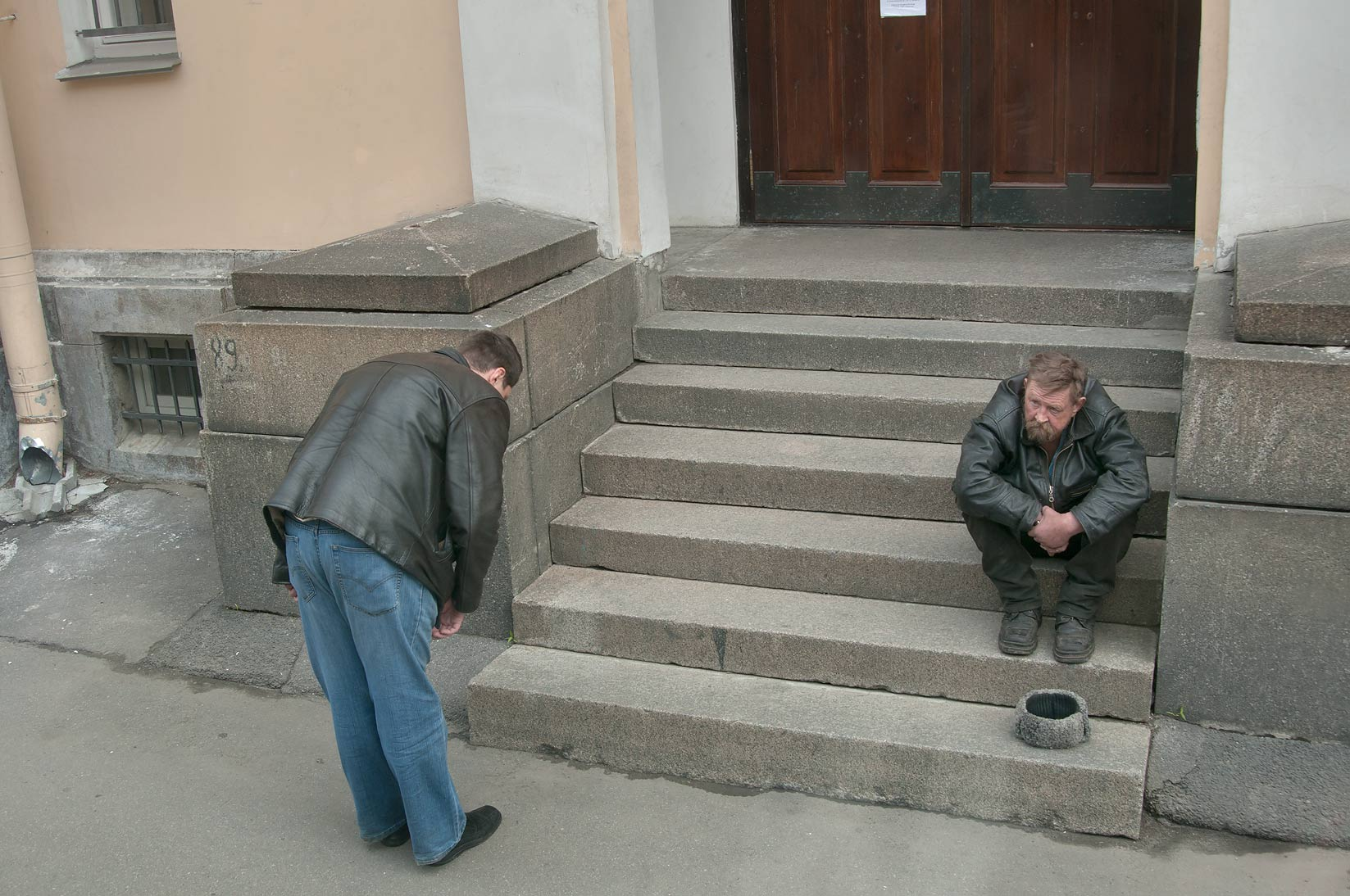 Praying at the entrance of Anna Kashinskaya...from a tour bus. St.Petersburg, Russia