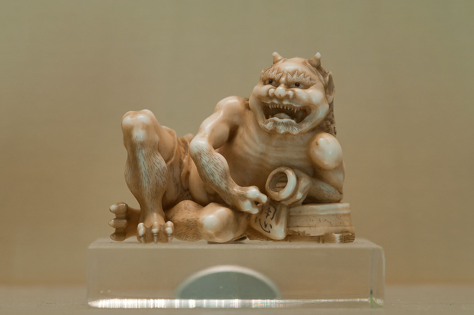 Japanese ivory figure (Demon with a cup of sake...Museum. St.Petersburg, Russia