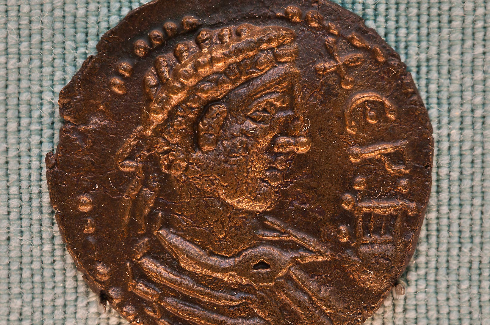 Ancient Greek copper coin from Khersones in Hermitage Museum. St.Petersburg, Russia