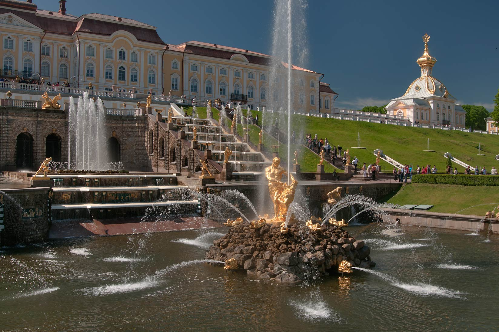 Fountains of Grand Cascade and a palace in Peterhof, west from St.Petersburg. Russia