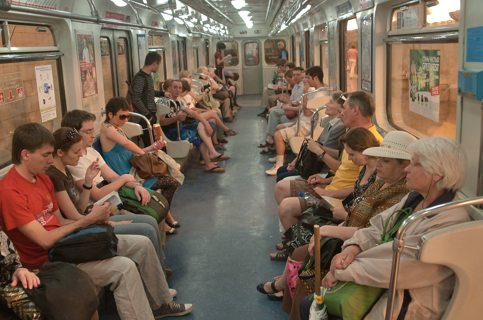 Passengers sitting in a train of subway (Metro). St.Petersburg, Russia