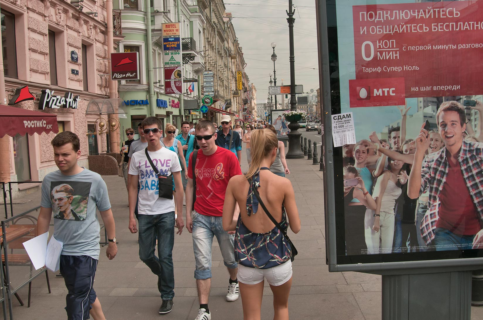 Pedestrians walking on Nevsky Prospect. St.Petersburg, Russia