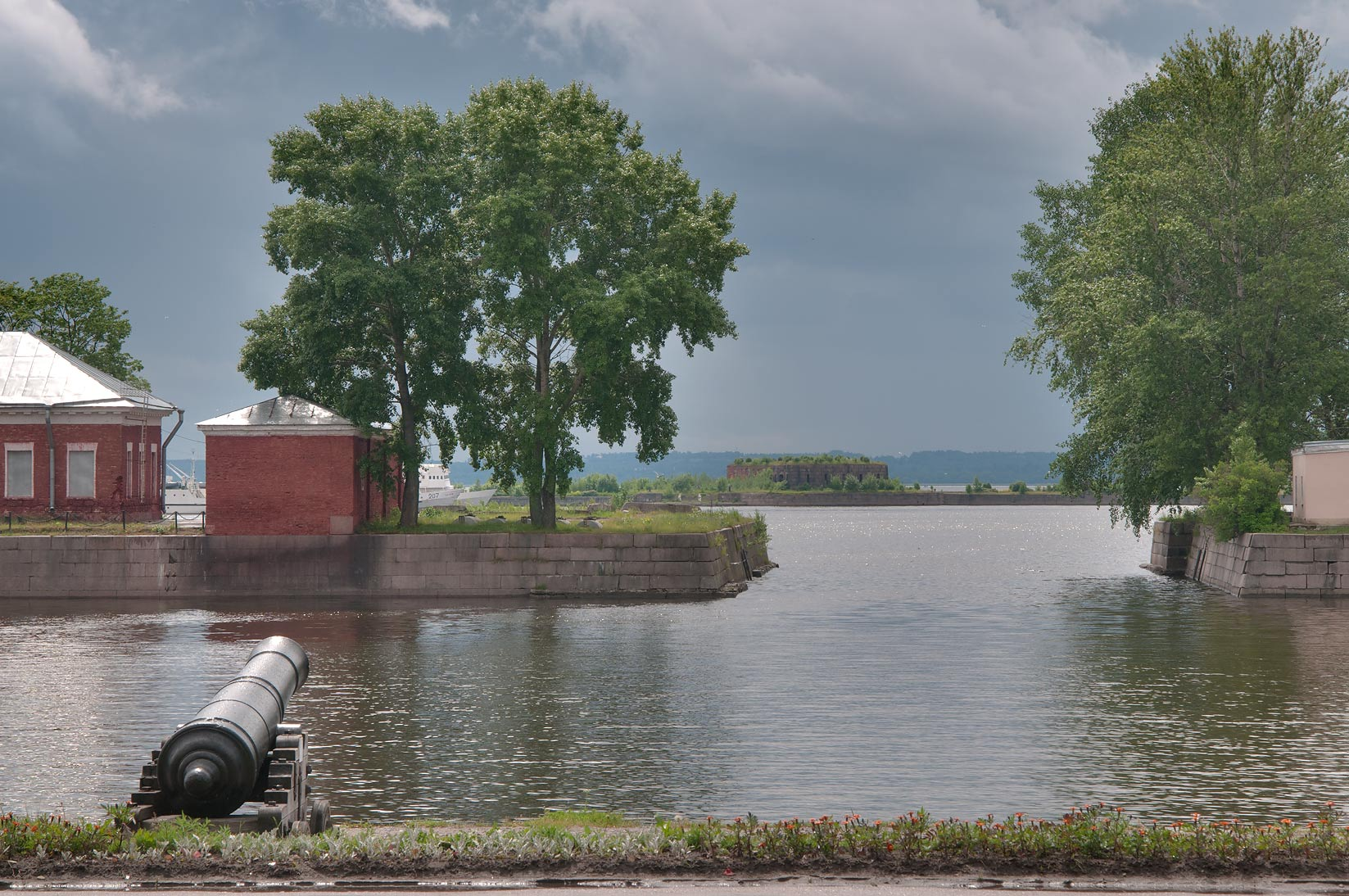Old cannon and Italyansky Prud (Italian Pond...in Kronstadt. St.Petersburg, Russia