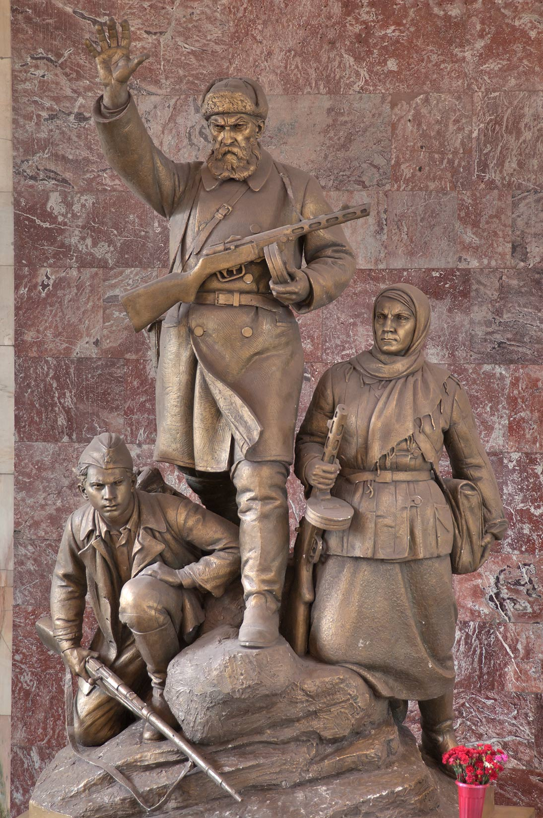 Bronze monument of guerrilla soldiers on subway...Metro) Partizanskaya. Moscow, Russia