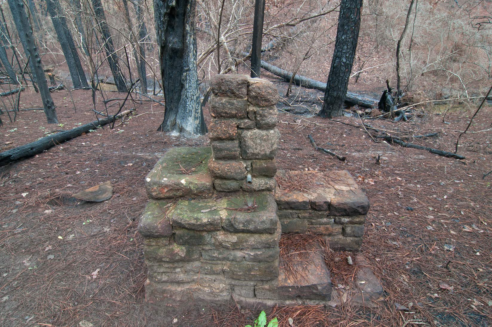 CCC Water Fountain revealed by fire on eastern...in Bastrop State Park. Bastrop, Texas