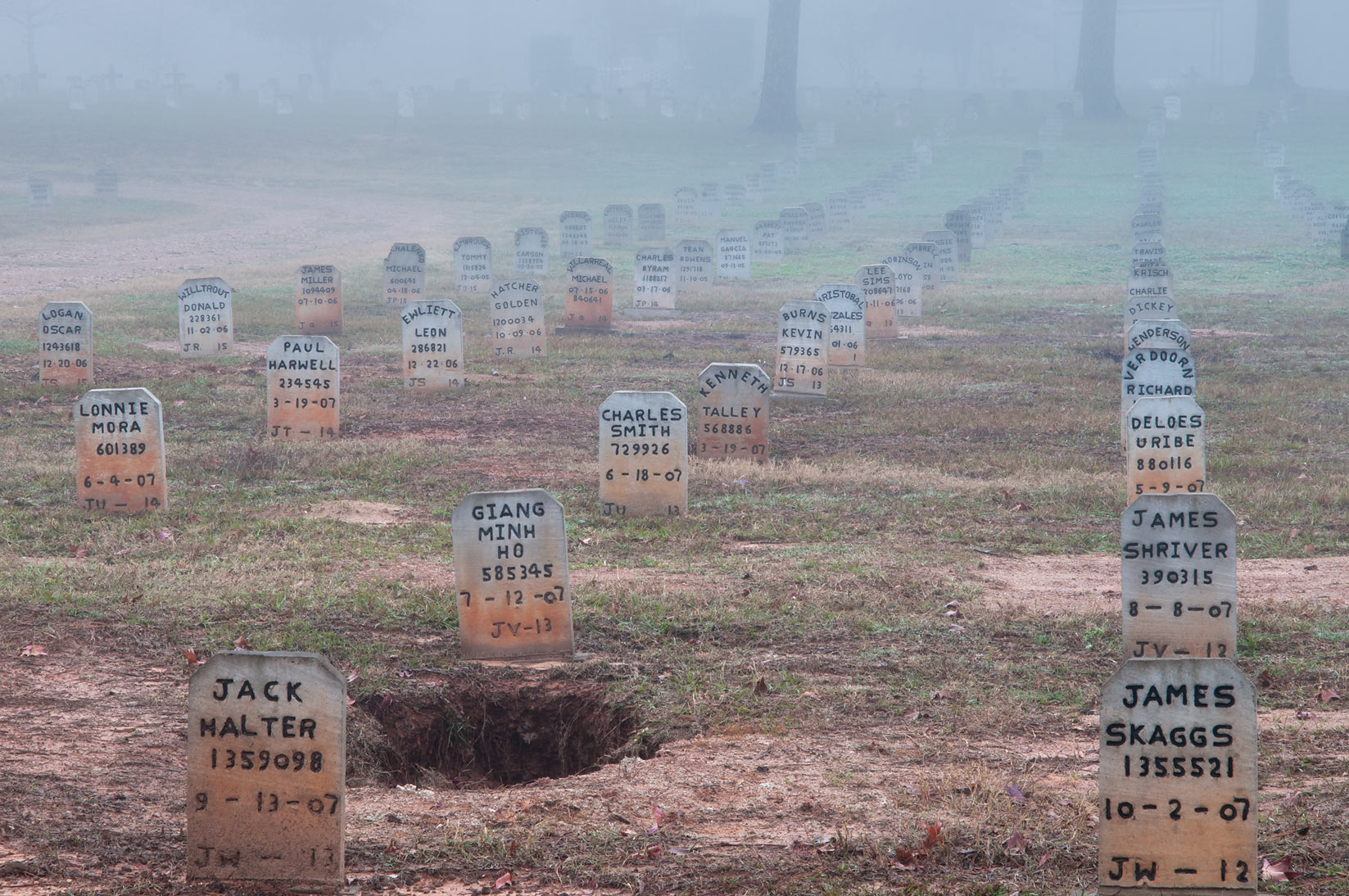 Recent headstones of TDCJ Captain Joe Byrd...Cemetery in fog. Huntsville, Texas
