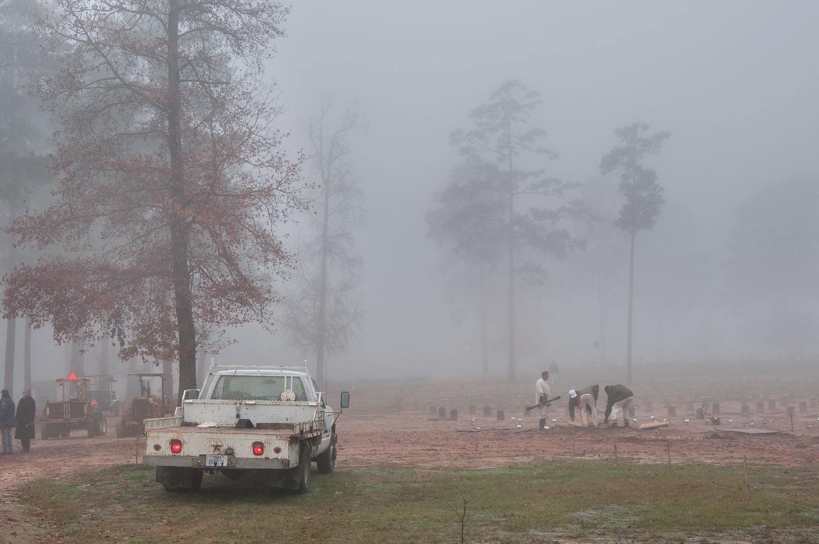 Group of inmates burying deceased prisoners in...Cemetery in fog. Huntsville, Texas