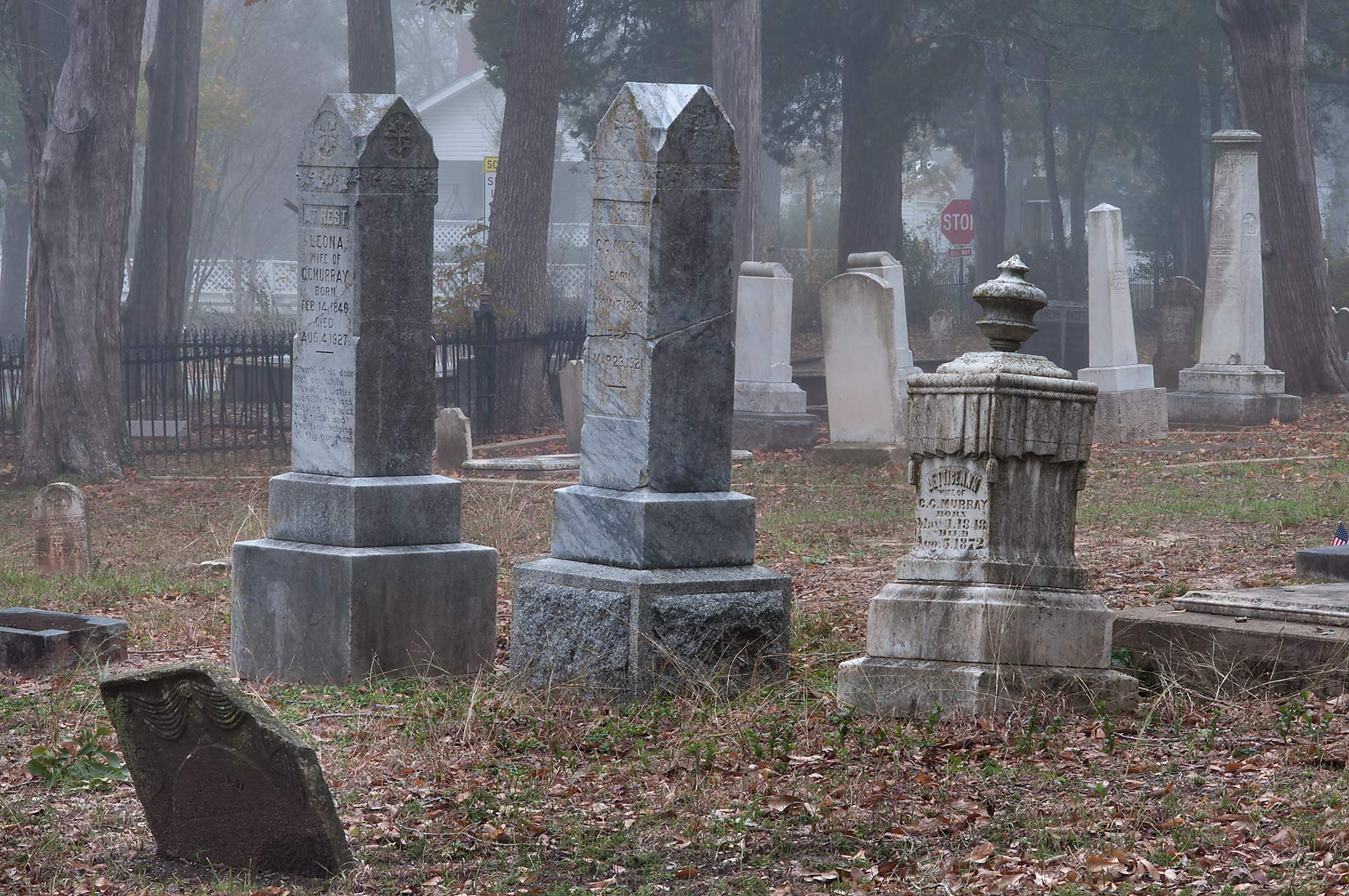 Large headstones of Oakwood Cemetery in fog. Huntsville, Texas