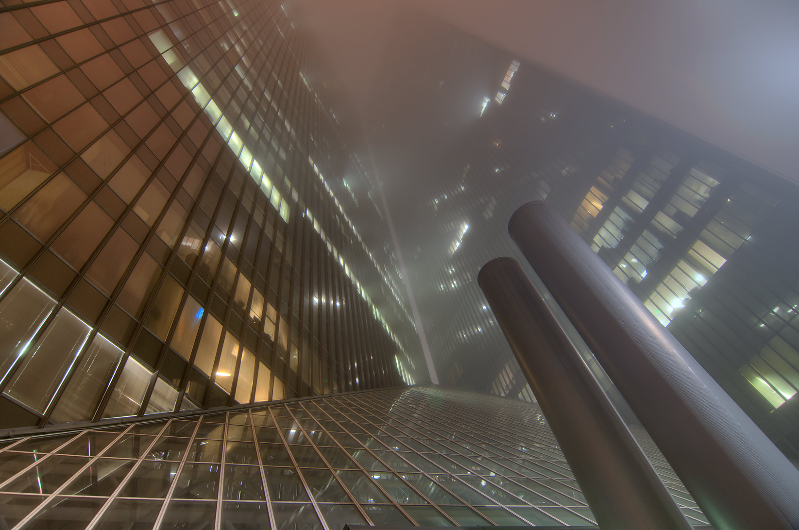 Pennzoil Place in downtown in fog. Houston, Texas