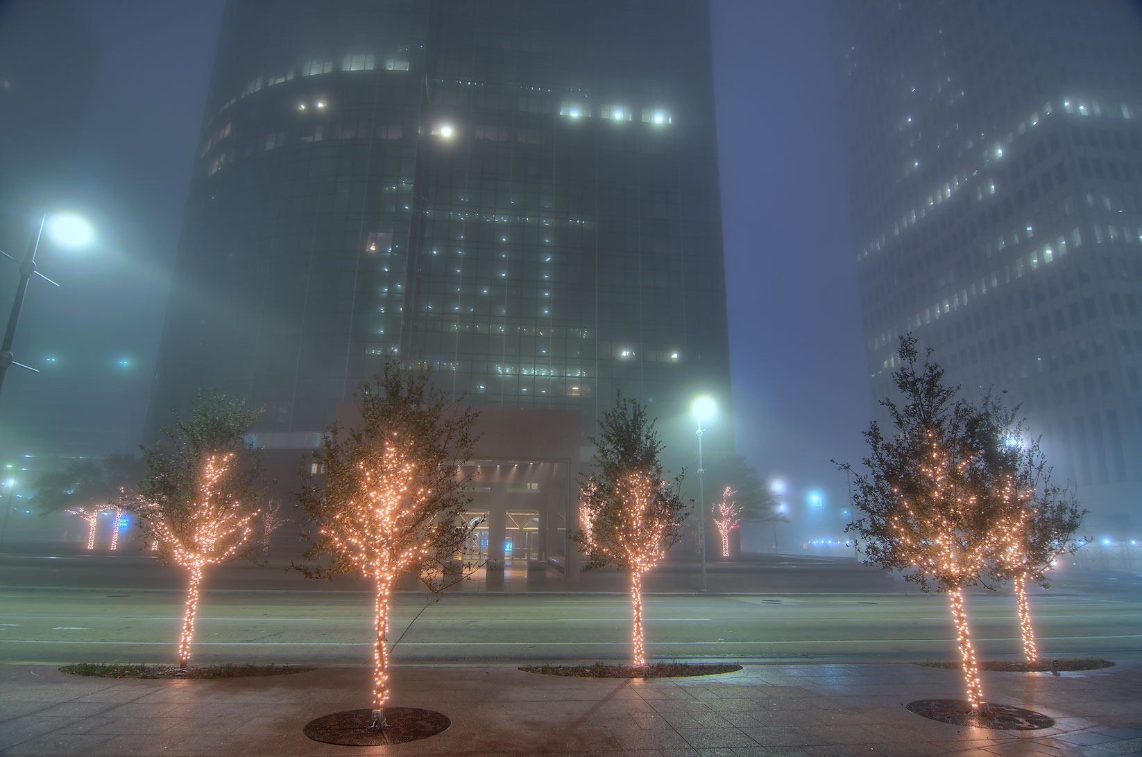 Christmas trees in downtown in fog at morning dusk. Houston, Texas
