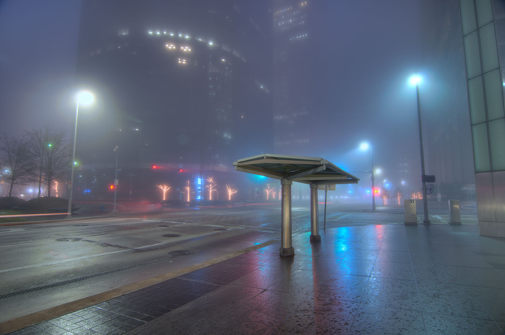 Bus stop in downtown in fog at morning dusk. Houston, Texas