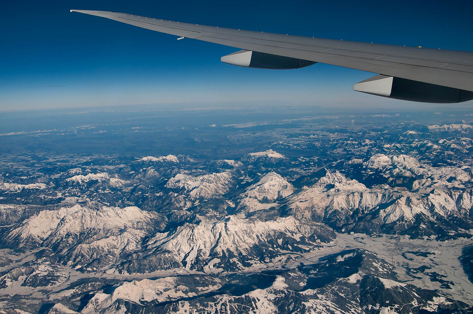 Leogang Mountains and a town of Saalfelden in...window of a plane from Houston to Doha