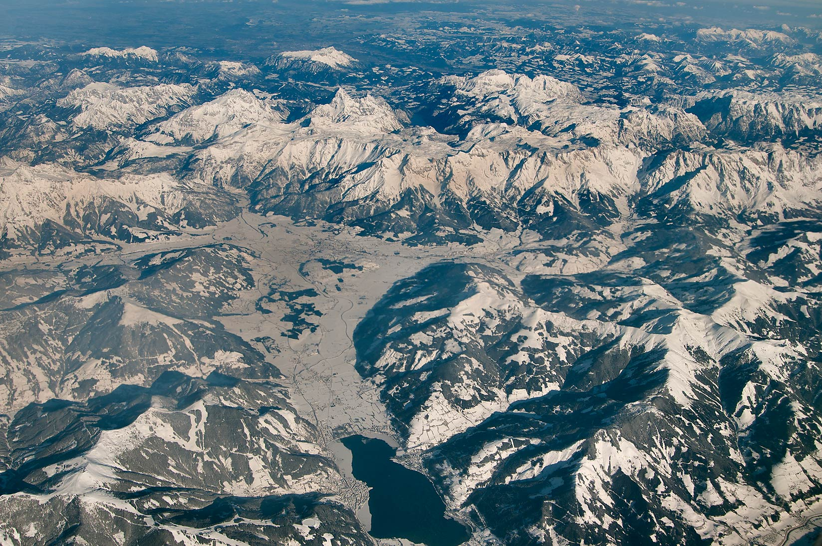 Saalfelden and snowy mountain peaks in the...window of a plane from Houston to Doha