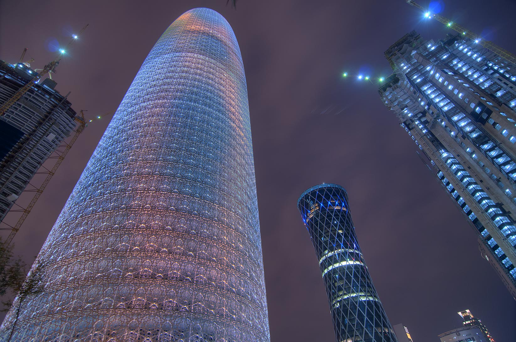 Groovy lighted Burj Qatar (phallic) Tower in West Bay. Doha, Qatar