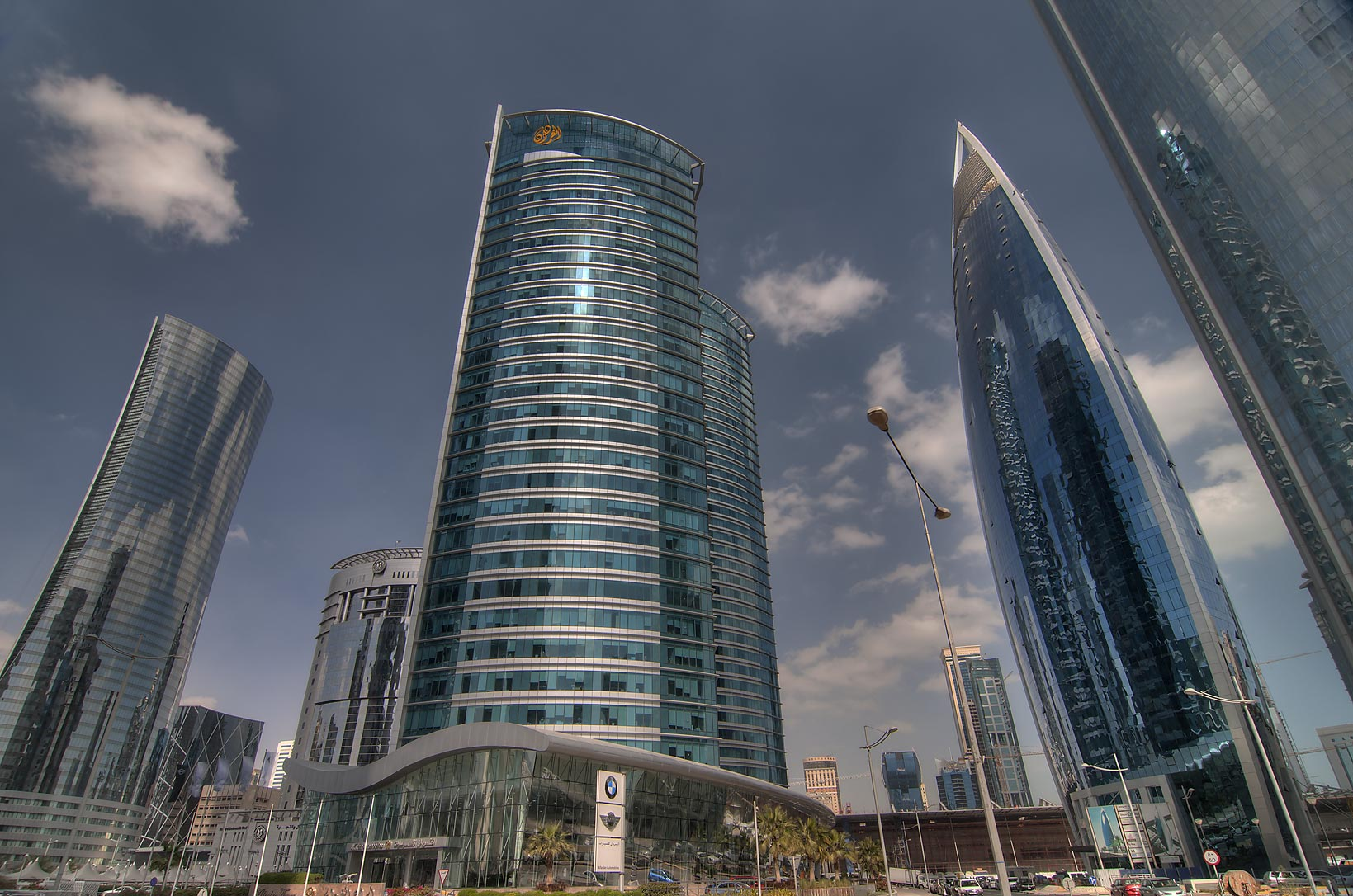 Navigation, Al Fardan, and Woqod towers in West Bay from Al Funduq St.. Doha, Qatar