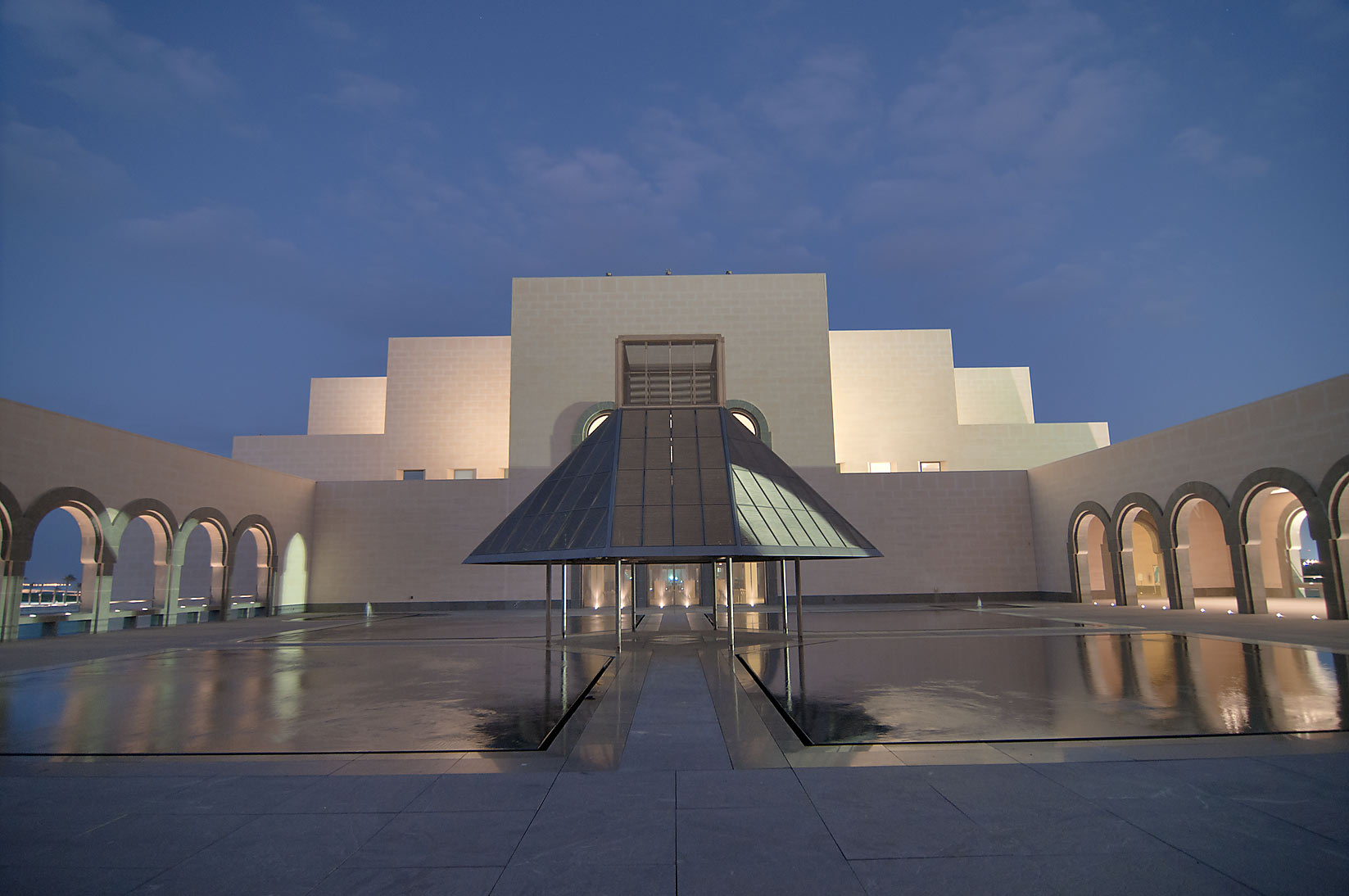 Fountain courtyard of Museum of Islamic Art at evening. Doha, Qatar