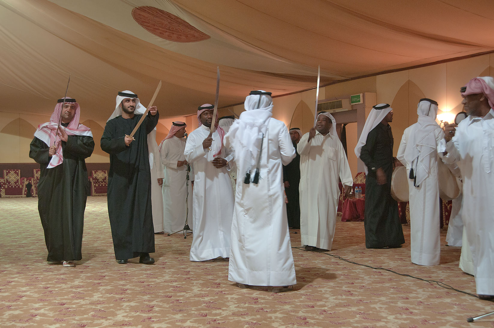 Sword dancing at a Qatari wedding. Doha, Qatar