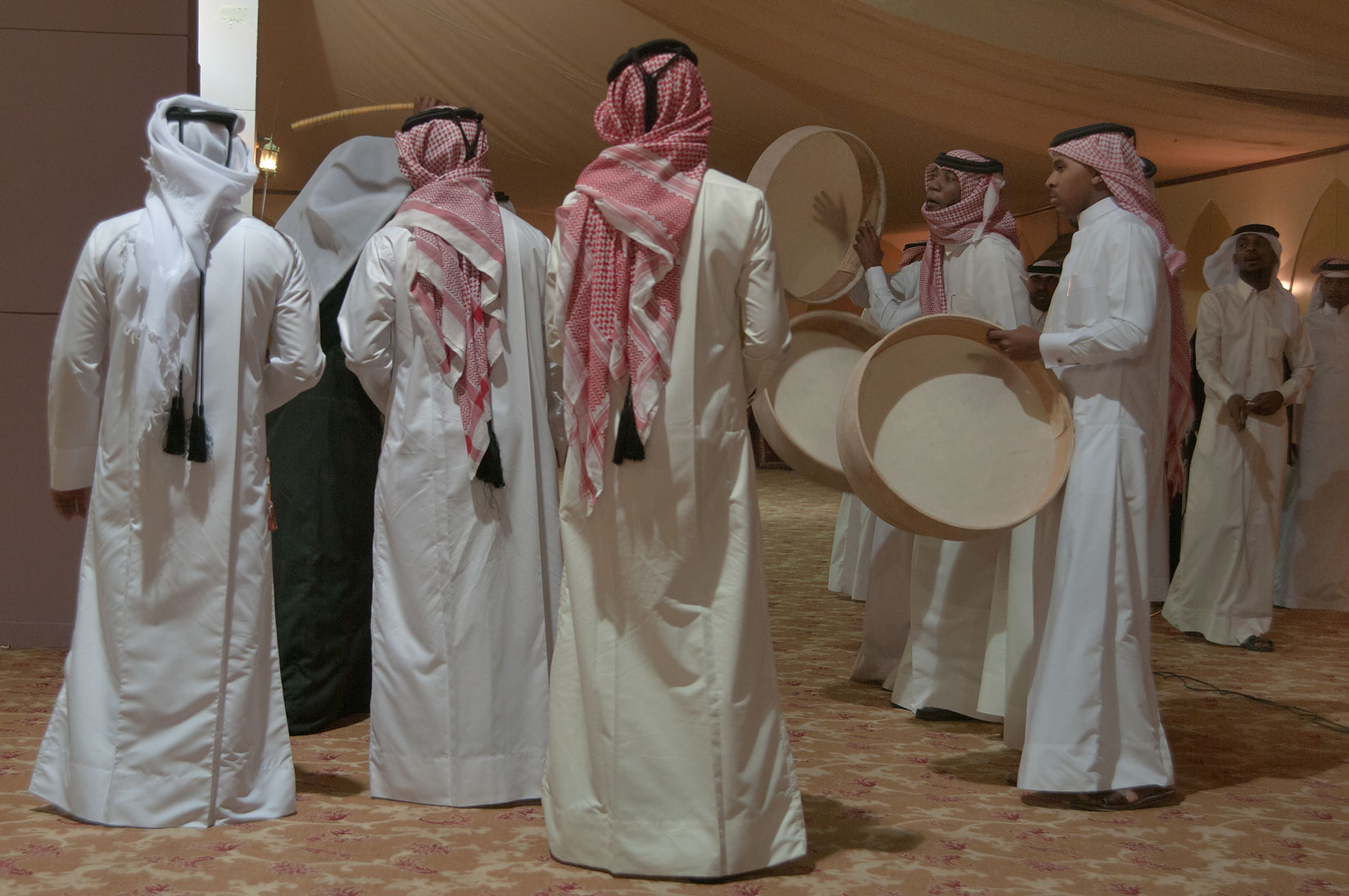 Traditional dancing at a Qatari wedding, in a tent. Doha, Qatar