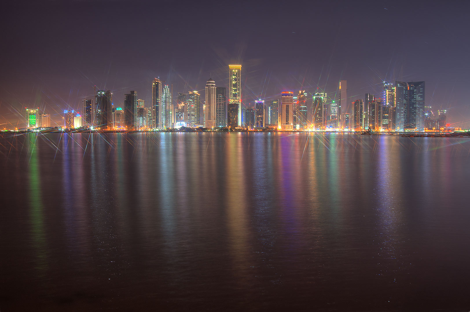 Reflections of West Bay from a beach near InterContinental Hotel. Doha, Qatar