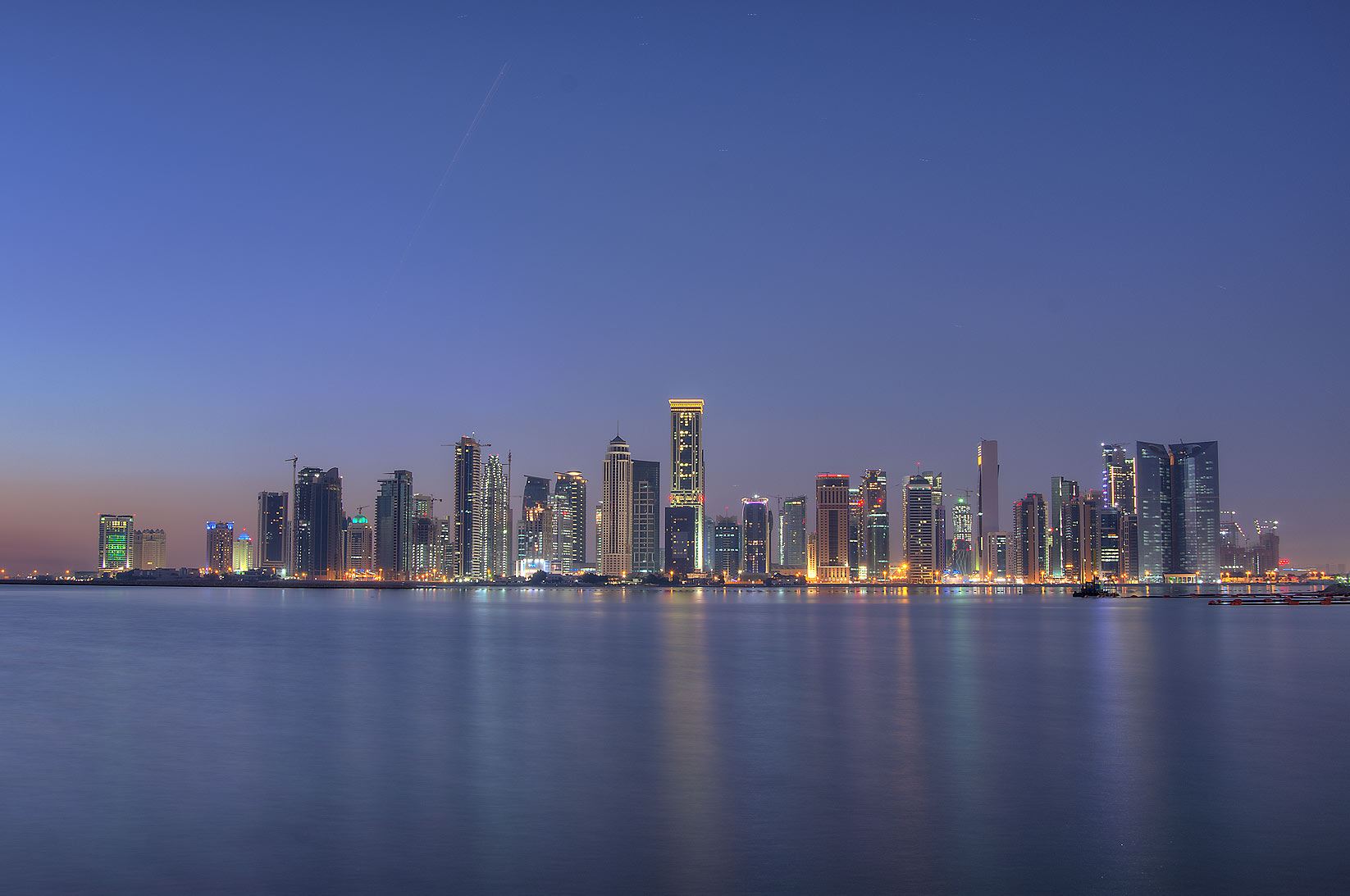 West Bay area from a beach near InterContinental Hotel at morning dusk. Doha, Qatar