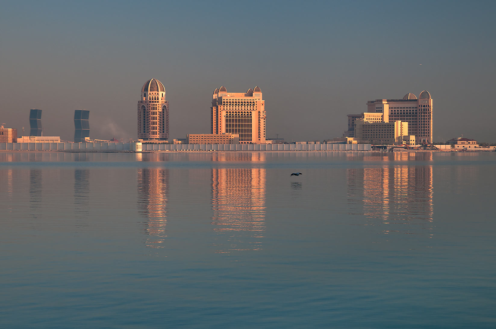 Reflections of InterContinental Hotel from a beach near Asas Twin Towers. Doha, Qatar