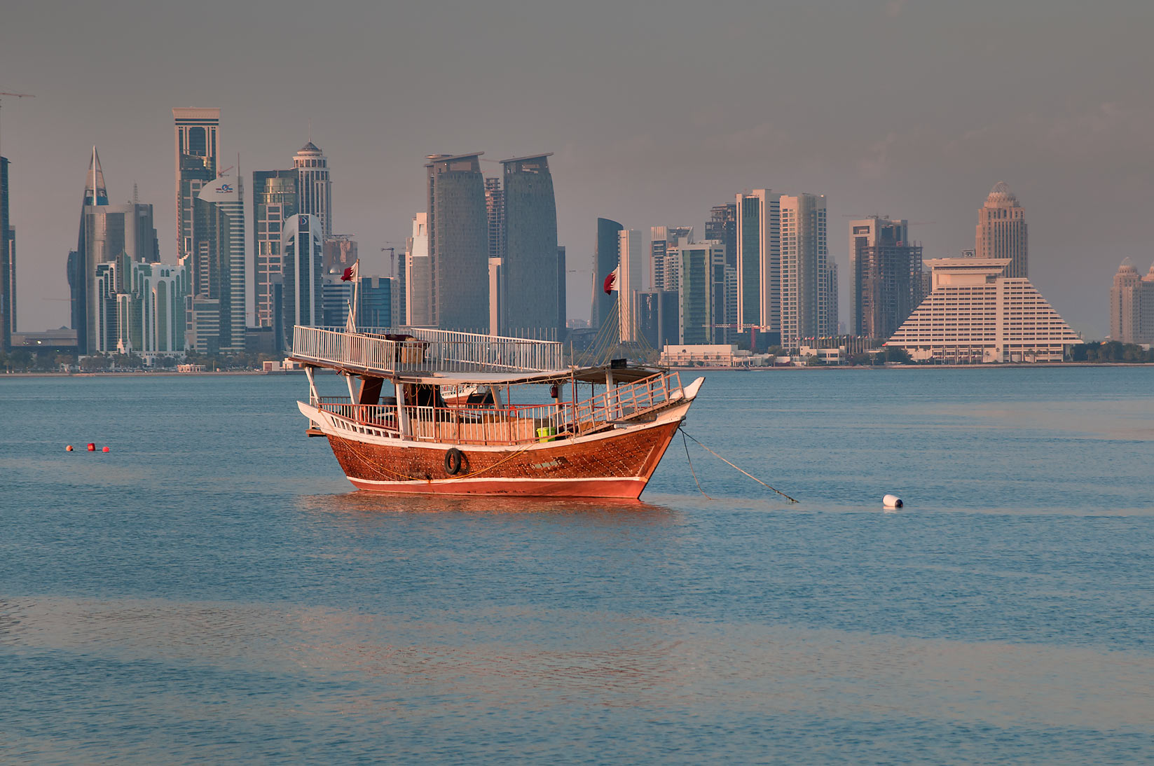 Dhow boat and West Bay in background, view from...near Corniche Round About. Doha, Qatar