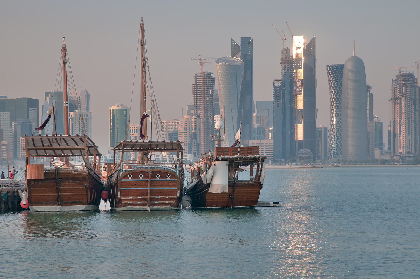 Fishing boats and West Bay in background, view...near Corniche Round About. Doha, Qatar