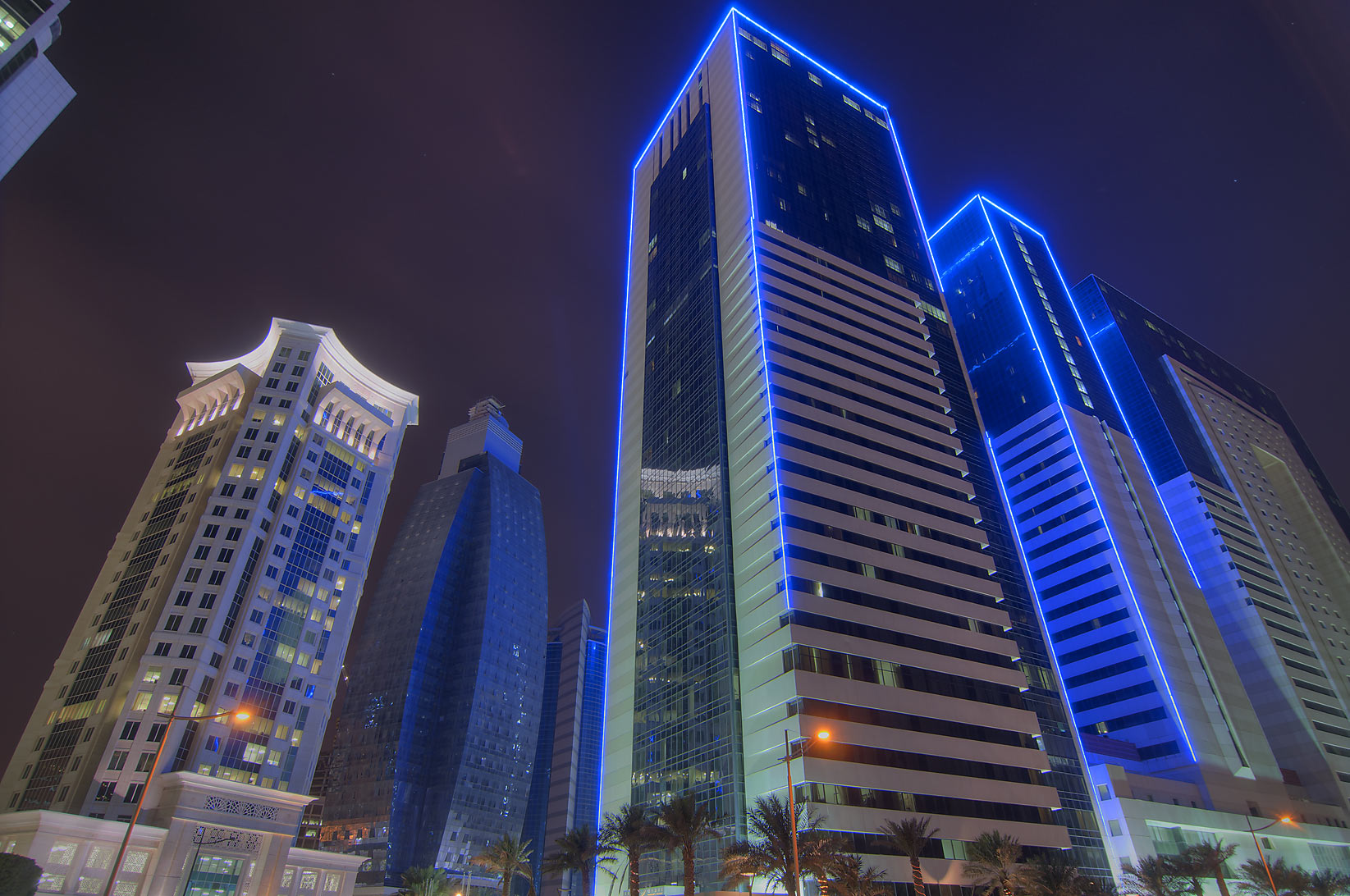 Al Qassar Tower and Ezdan Hotel in West Bay. Doha, Qatar
