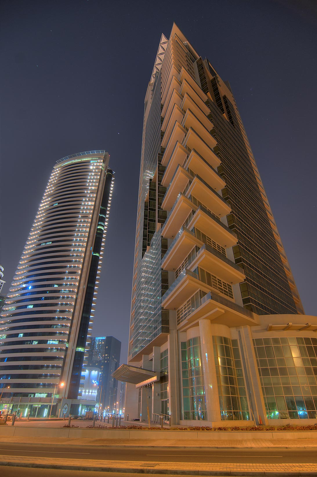 44 West Bay and Al Rayyan buildings from Diplomatic St.. Doha, Qatar