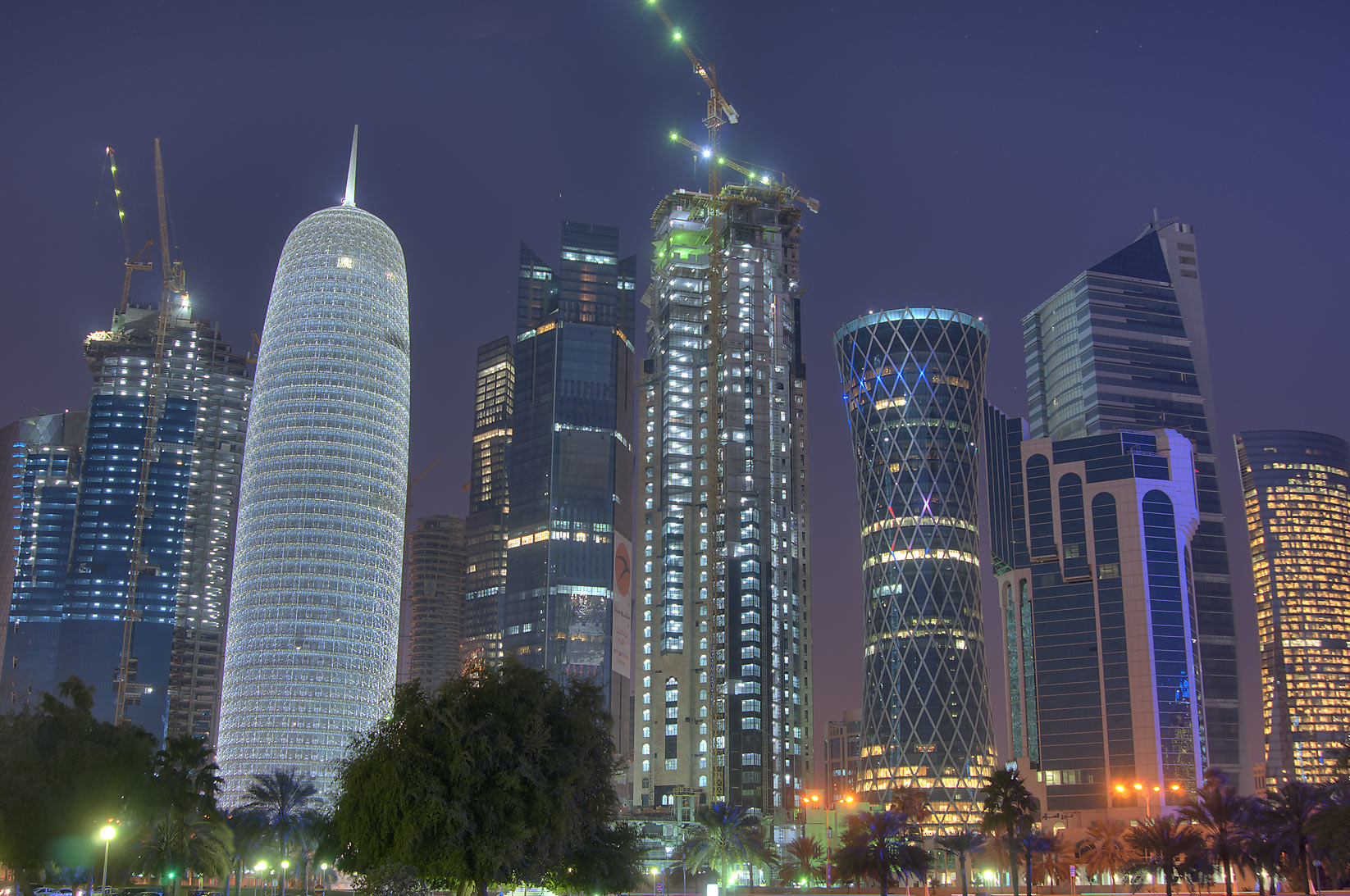 Burj Qatar (white lighted) and West Bay from Sheraton Park at morning. Doha, Qatar