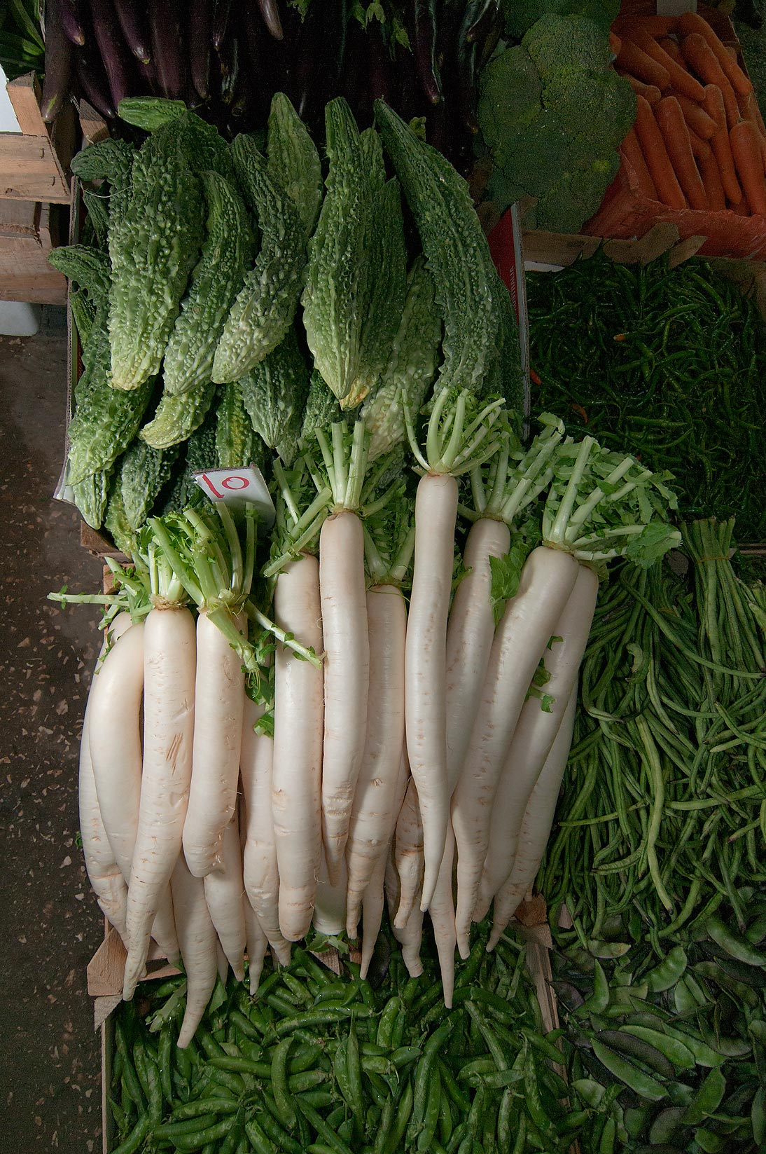 Horseradish in vegetable market. Doha, Qatar