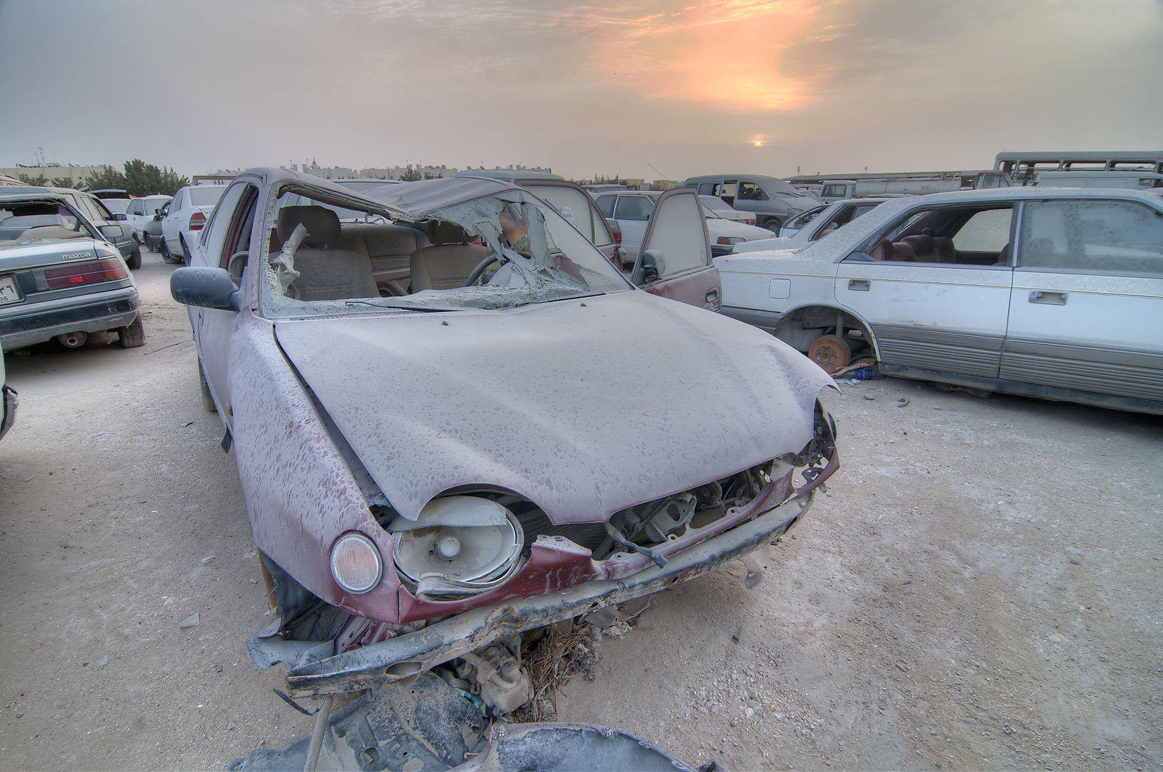 Old cars at sunrise near Al Mamoura Traffic...Division, Traffic Patrol). Doha, Qatar