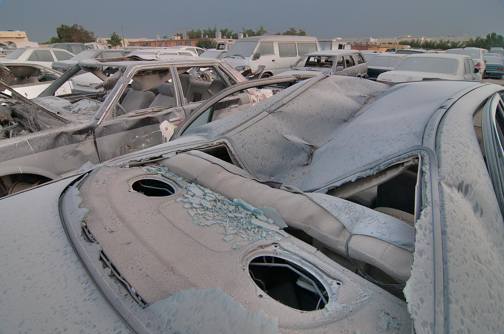 Damaged windshields of a car parked near Al...Division, Traffic Patrol). Doha, Qatar