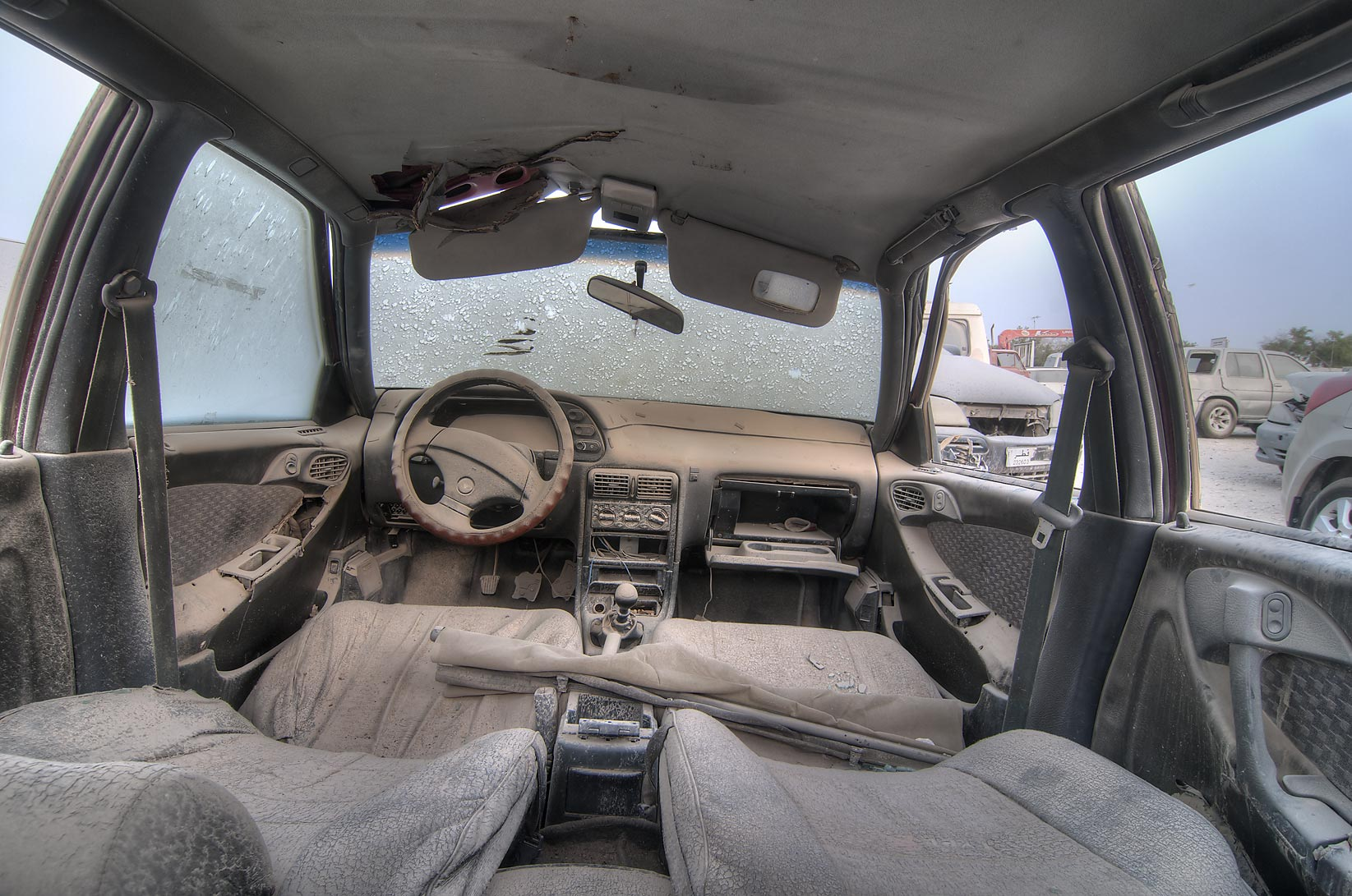 slideshow 1015 26 dusty interior of a car parked near al mamoura division traffic patrol. Black Bedroom Furniture Sets. Home Design Ideas