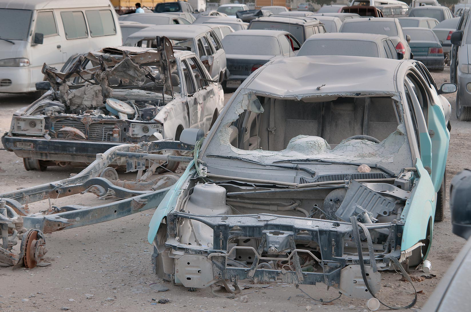 Crashed cars parked near Al Mamoura Traffic...Division, Traffic Patrol). Doha, Qatar