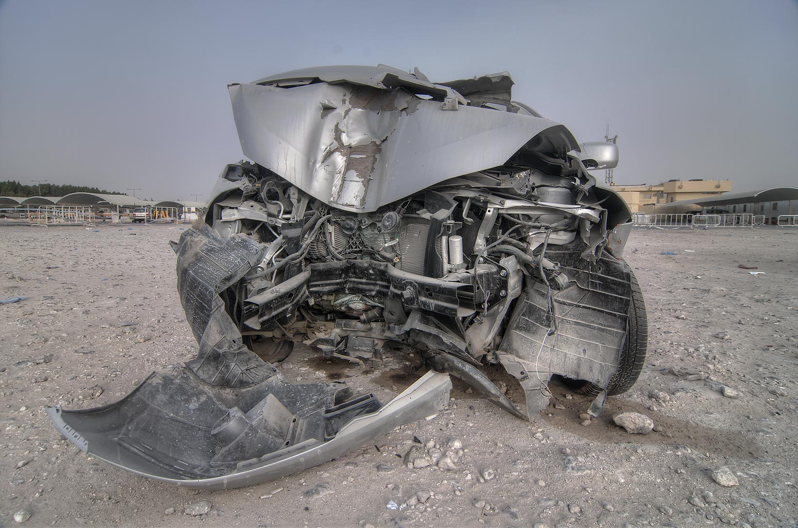 Damaged car near Al Mamoura Traffic Police and...Division, Traffic Patrol). Doha, Qatar