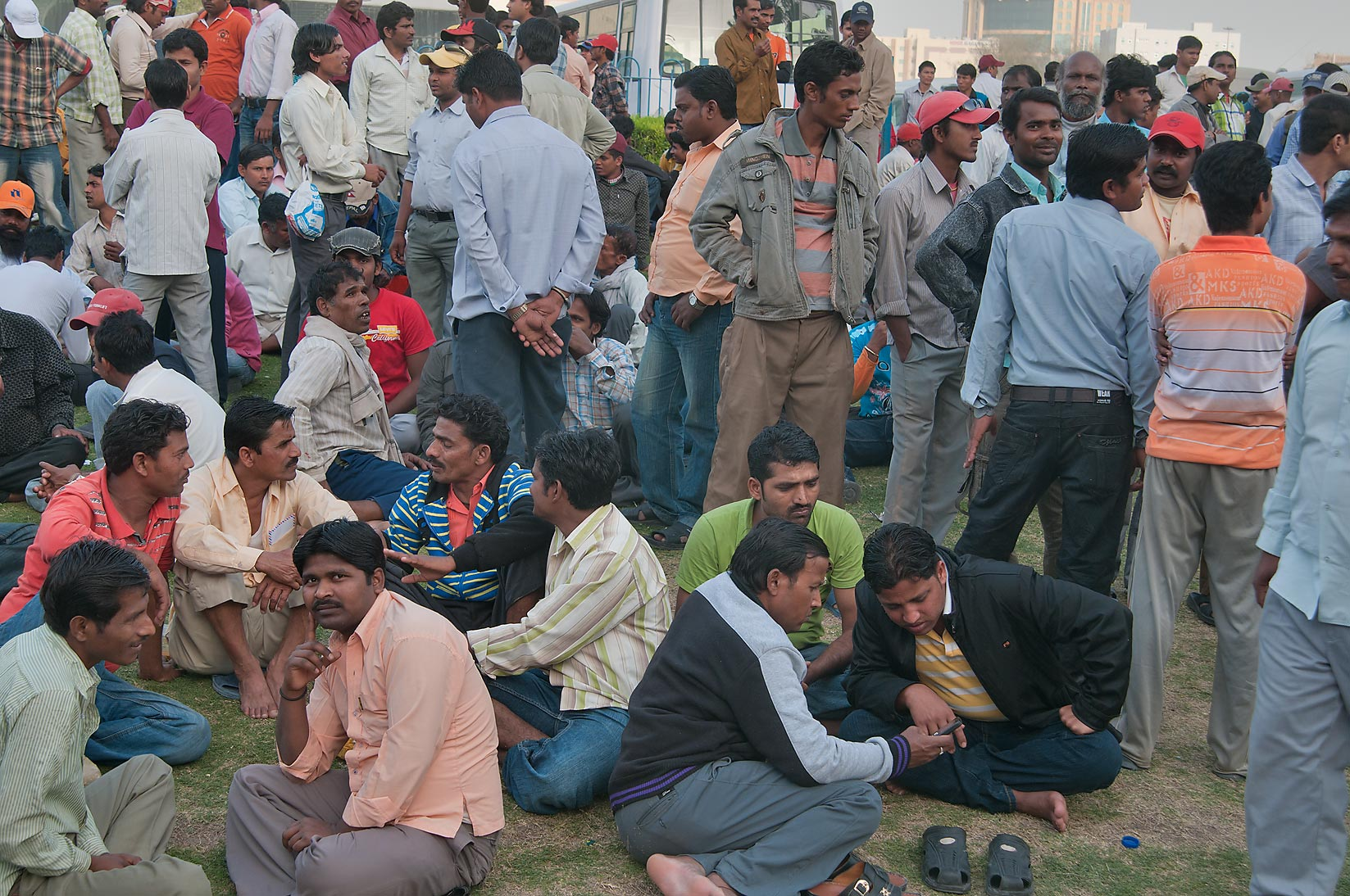 Migrant workers gathering on Friday evening on a...Al Ghanim) Bus Station. Doha, Qatar
